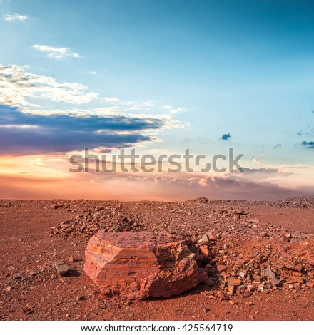 red land with stones in iron oxide quarry in Kryvyi Rih, Ukraine - stock photo