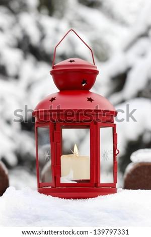 Red lantern, winter garden decor - stock photo