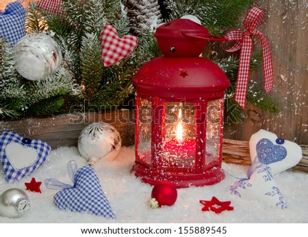 Red lantern with candlelights for Christmas decoration.