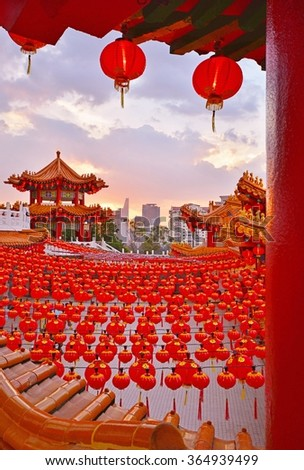 Red Lanterns hanging on Temple roof  during sunset.The Thean Hou Temple is a landmark six-tiered Chinese temple in Kuala Lumpur, Malaysia. - stock photo