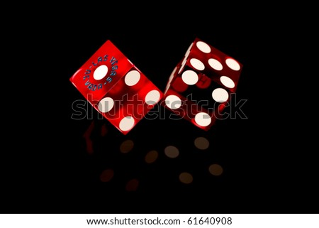 Red Las Vegas Craps Game Dice isolated on a black background. - stock photo