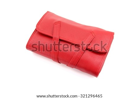 Red leather bag on white background. - stock photo