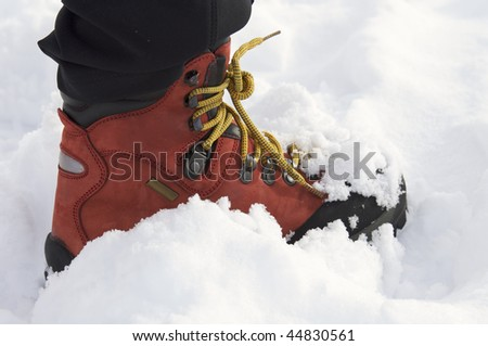 red leather boot with laces yellow mountain - stock photo