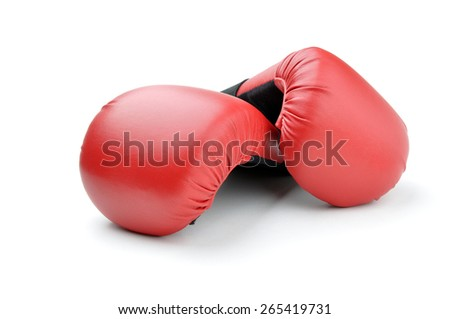 red leather boxing gloves for punching bag or for karate on white background - stock photo