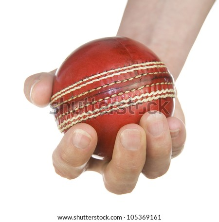 red leather cricket ball in hand on white background with copy space - stock photo