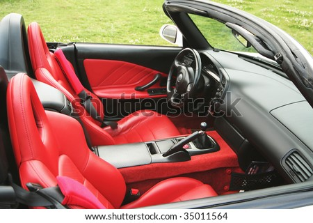 red leather fair of the sport car - stock photo