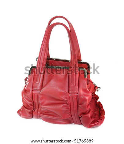 Red leather handbag is isolated on a white background