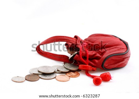 red leather pouch with change on white - stock photo
