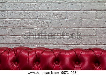 Red Leather Sofa In A White Brick Wall / Red Sofa