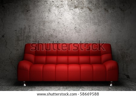 red leather sofa in front of grunge concrete wall - stock photo