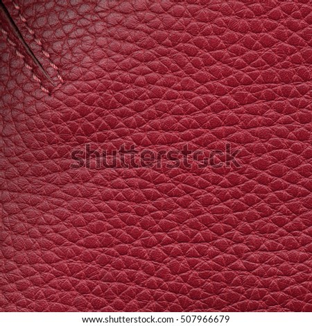 red leather texture closeup,fold,stitches