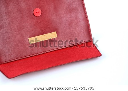 red leather texture envelope with Velcro on white - stock photo
