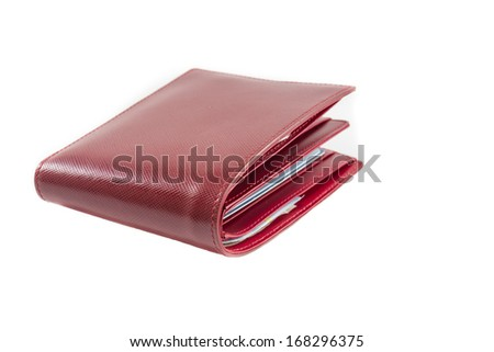 Red leather wallet with a little polka. - stock photo