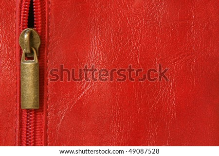 Red leather with zipper background closeup - stock photo