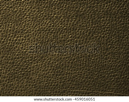 Red leatherette texture useful as a background vintage sepia