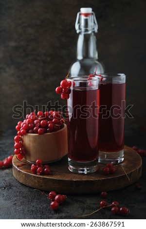Red lemonade with berries on a vintage wooden table - stock photo