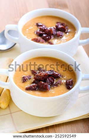 Red lentil  and chorizo soup in bowls - stock photo