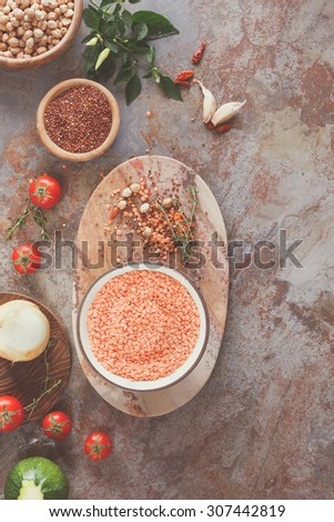 Red Lentil Quinoa Soup ingredients. Lentil soup with quinoa, Red lentil soup with chickpeas, vegetable and spices  being prepared, top view - stock photo