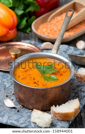 red lentil soup with spices, vertical