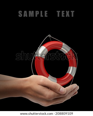 Red lifebelt. Man hand holding object  isolated on black background. High resolution  - stock photo