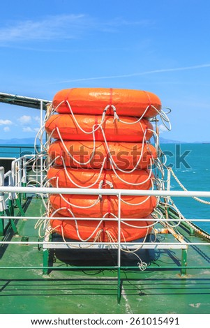 red lifebuoy on ship safety equipment - stock photo