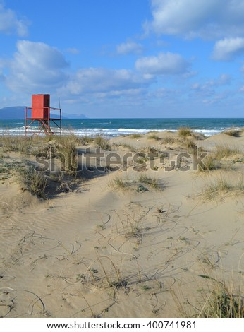 Red Lifeguard Station on Beach - stock photo