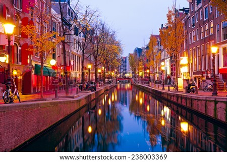 Red light district in Amsterdam the Netherlands at night - stock photo