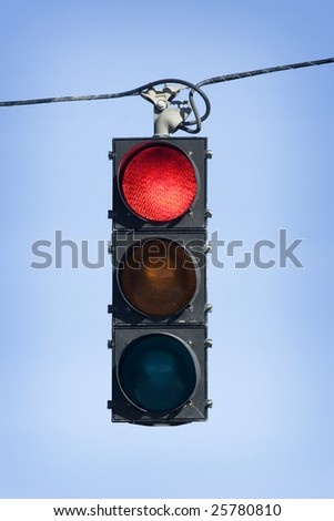 Red light hanging above street - stock photo