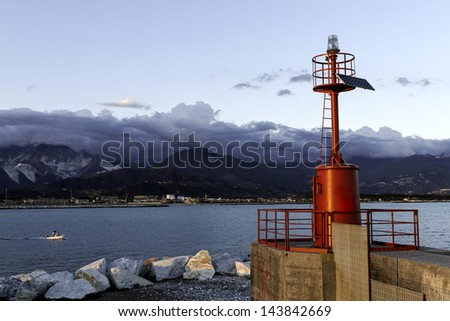 Red Light House in Marina di Carrara harbor, Italy. - stock photo