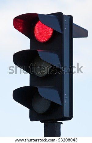 red light on black traffic signal - stock photo