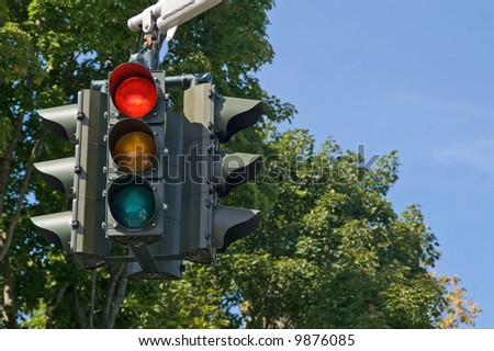 Red light on the traffic signal means stop - stock photo