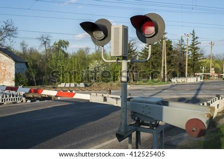red light semaphore on railway crossing - stock photo