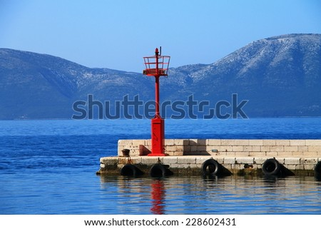Red lighthouse in small mediterranean town Gradac , Croatia - stock photo