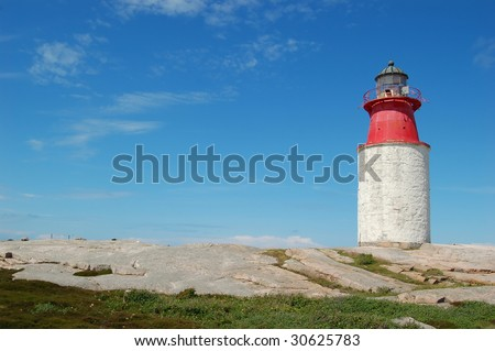 Red lighthouse on the small island in front of Smughen - stock photo