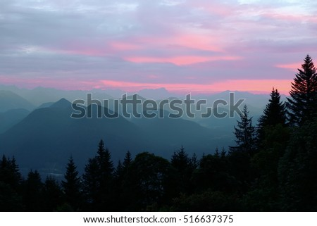 red lights over the bavarian alps at evening