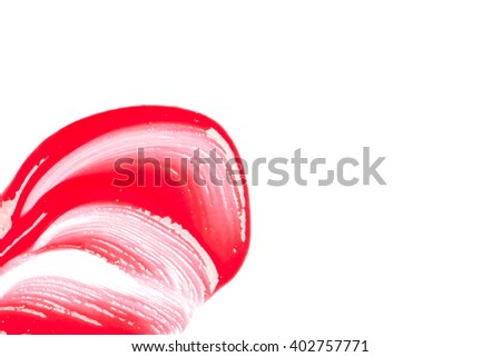 Red lip gloss on a white background close-up. - stock photo