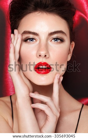 Red lips and blue eyes. Close up portrait. Fashion beauty shot. Beautiful model.  - stock photo