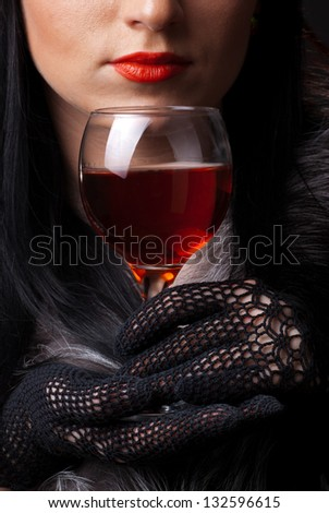 Red lips and glass of wine close up - stock photo