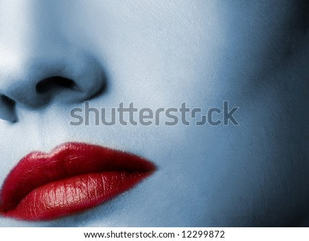 Red lips and skin toned in blue - stock photo