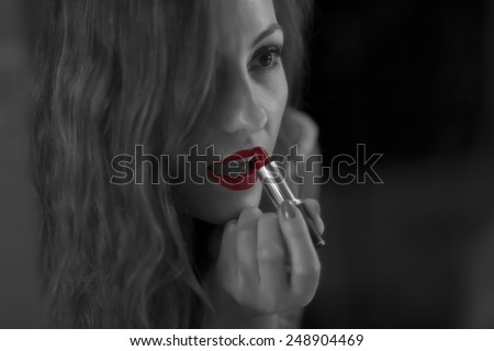 red lips's of a young woman with a black and white photo / lipstick and make up  - stock photo