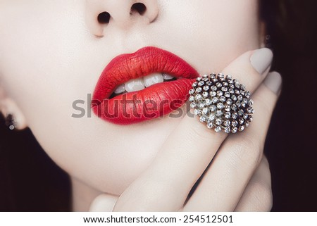 Red Lips with Diamond Jewelry. Fashion Make-up, Style and Cosmetics - stock photo