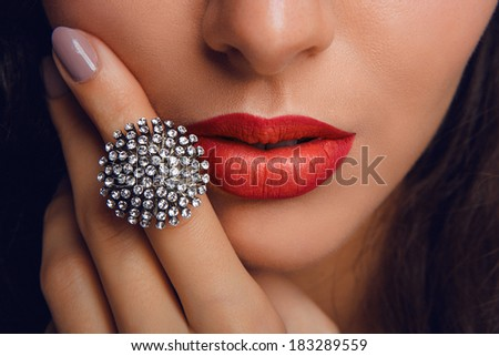 Red lips with the ring. Make up - stock photo
