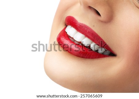 red lipstick and white teeth