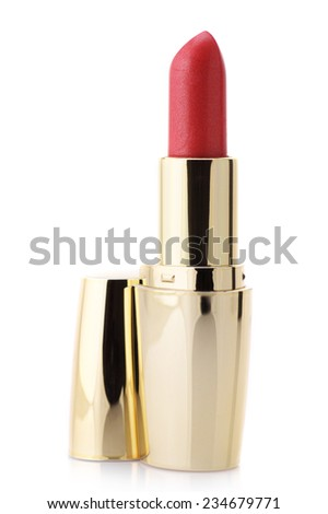 Red lipstick in golden container isolated on white background.