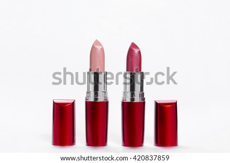 red lipstick on light background