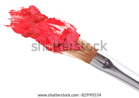 Red lipstick stroke (sample) with makeup brush, isolated on white - stock photo