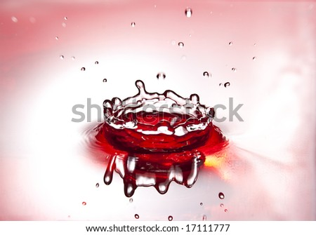 red liquid crown - stock photo
