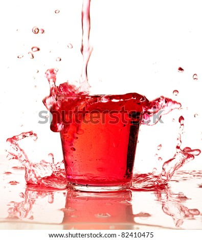 red liquid splashing isolated on white background
