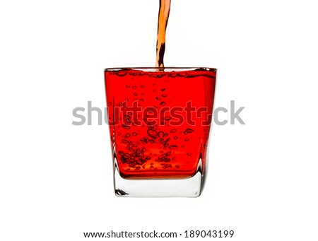 red liquid splashing isolated on white background. with clipping path. - stock photo