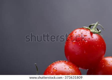 red little round   fresh tomatos and green pods